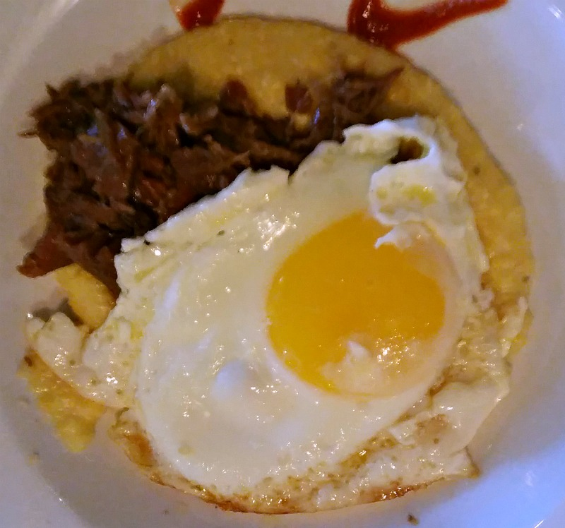 grits-lamb-and-a-fried-egg-at-bistro-at-the-bijou