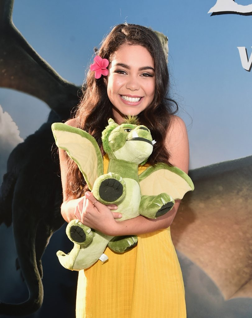 "HOLLYWOOD, CA - AUGUST 08:  Actress Auli'i Cravalho arrives at the world premiere of Disney's ""PETE'S DRAGON"" at the El Capitan Theater in Hollywood on August 8, 2016. The new film, which stars Bryce Dallas Howard, Robert Redford, Oakes Fegley, Oona Laurence, Wes Bentley and Karl Urban and is written and directed by David Lowery, has been drawing rave reviews from both audiences and critics. PETE'S DRAGON opens nationwide August 12, 2016.  (Photo by Alberto E. Rodriguez/Getty Images for Disney ) *** Local Caption *** Auli'i Cravalho"