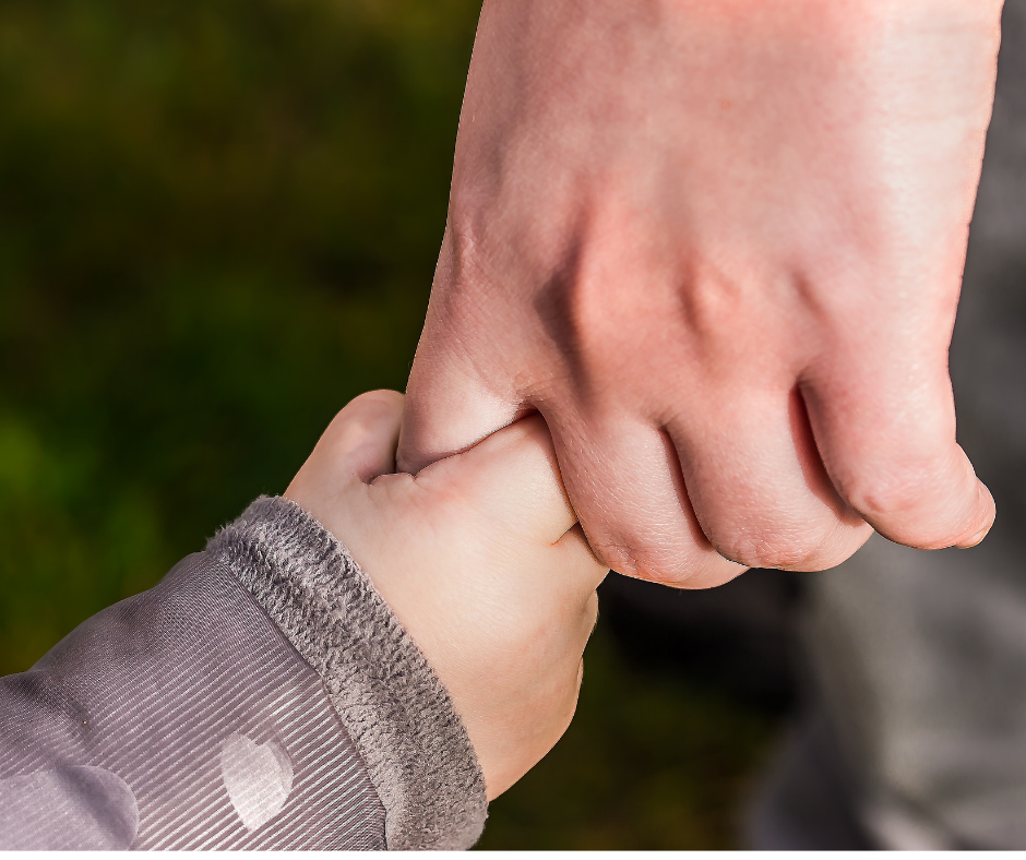 Child and Adult holding Hand Travel Hacks
